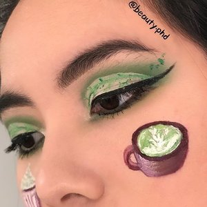 {matcha-cha-cha}  Teaser for my new look. Took a while to pick a picture I liked and my boyfriend's opinion was 'they all look the same..'  Anyhoo, I hope you like this tea leaf  inspired eye look with mini drawings of a matcha latte! I get those really often and have tried so many from the places near my workplaces (cafes, Starbucks, boba shops). Starbucks is pretty good I must say,I get it almost every single time I go! Venti green tea latte with soy milk? Half and half? What kind of milk do you like your lattes with? _____  🌿Brows🌿  @anastasiabeverlyhills brow powder duo @benefitcosmeticssg gimme brow  🍃Eyes & Details🍃  @plouise_makeup_academy base in rumor 02 @jamescharles @morphebrushes James Charles palette @kpalette_sg one day tattoo real long lasting eyeliner in super black  @lancomeofficial monsieur big mascara @jeffreestarcosmetics velour liquid lipsticks in equality, posh spice, triggered @inglot_cosmetics @inglot_usa AMC gel liner in 76,84; duraline  _____ #inglotcosmetics #jeffreestarcosmetics #unleashyourinnerartist #morphebrushes #plouise #anastasiabeverlyhills #benefitbrows #cutcrease #matcha #tealover #undiscovered_muas #blazin_beauties #clozette #sgmua #nycbeauty #makeupselfie #wakeupandmakeup #creativemakeup #makeupart #makeupinspo #igmakeup #igsg #foodporn #closeupshot #closeup #closeupphotography