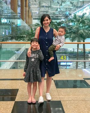 "At the airport 🛫last evening  to send our relatives off to 🇦🇺 , can't wait to visit them again this June ! This time round we're flying over👏🏻 Finally! #Iwaitedfor10years 😂  Kids outfit @mothercaresg @uniqlosg  @melissashoessg ❤️ Mine @jumpeatcry Understated Girlboss Nursing Dress in Navy (XS) Quote ""VINNA10"" 10% ❤️ @kedssg sneakers  #clozette  #sgmummy #jecmummies  #vinnaxjec"