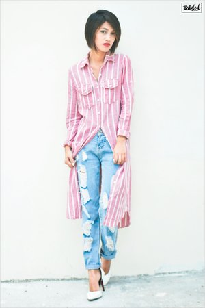 A shirt dress is a style of dress that borrows details from a man's shirt.This classic piece is now back to the forefront and my favorite part of it is that, it's a great combination of sexy and tomboy.