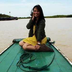 Military jacket, yellow dress, and boots. Memories of Cambodia.