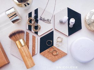 Making full use of all of my gold accessories, makeups and skincare for this #flatlay to match with my @sudio NIVÅ Wireless Earphone & the Swedish Design Coasters.  Madly in love with how this pair of elegant wireless earphone provide convenience to me. Thanks for coming into my music life 🎵🎶 Full blog review on @sudio NIVÄ Wireless Earphone is up in my blog, read it up now @ www.NicoleYie.com  Enjoy 15% discount on your purchase at  Sudio's website with my code . Other than that, they are also having a promotion by giving out FREE Pack of 4 Swedish Design Coasters and FREE Delivery to Malaysia.  #sudio #sudiosweden #sudiomoments