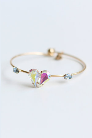 Fine gold bangle with crystal heart. Perfect for layering.