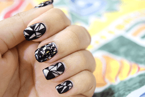 Punk rock glitter geometrical black and white nails