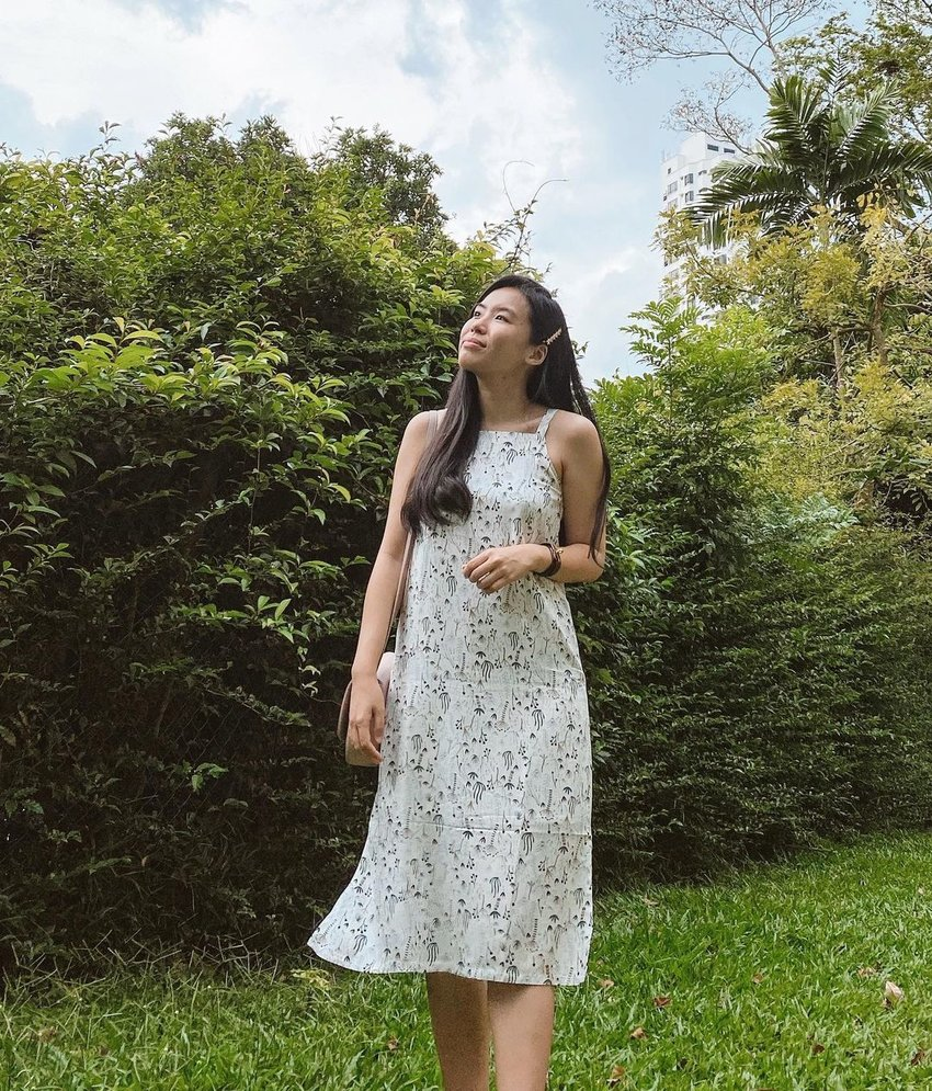 Girl in a white printed tunic dress