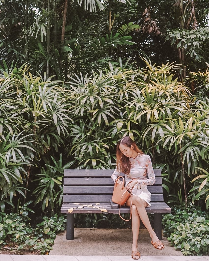 Another clever way of taking photos with plants is simply capturing a candid moment on a garden bench