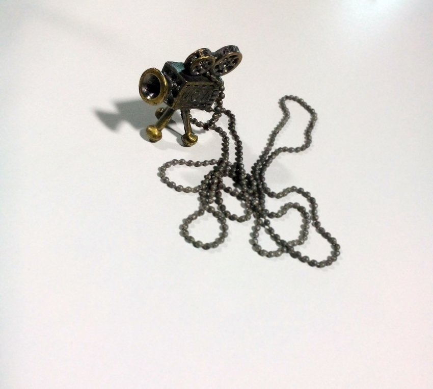Film buffs like me will love this piece. Vintage motion camera pendant for today's accessory.