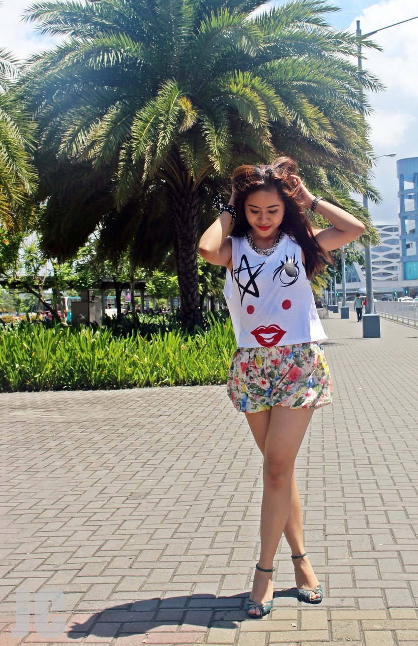 Having fun with this oufit shoot. Graphic muscle tee plus skort and  you're good to go!