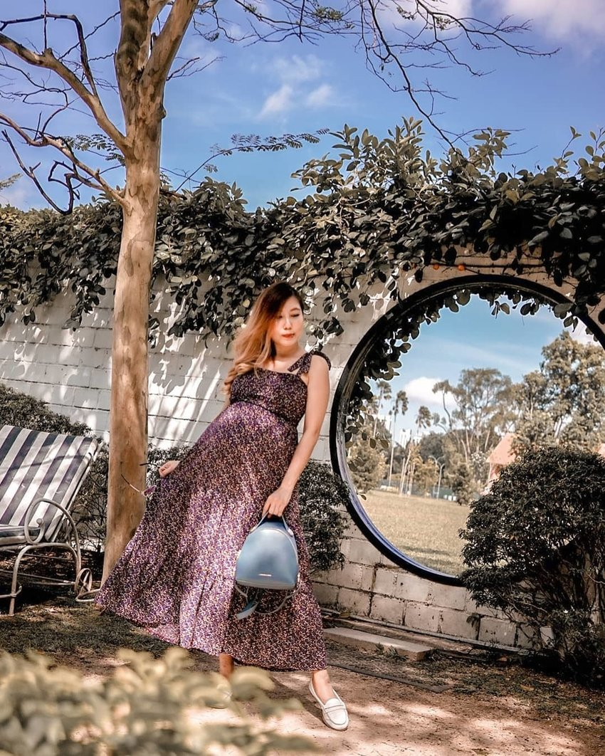 Pregnant woman in floral maxi dress