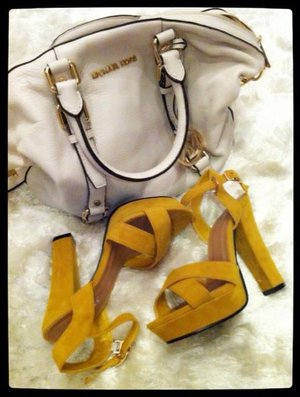 These days I'm in luv with Micheal Kors..as its reasonable price.bought this during sales time...n I luv to get my new bag a matching heels :) my way...